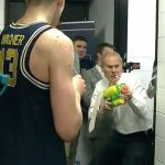 Michigan coach John Beilein ambushes team with a water gun after upset win
